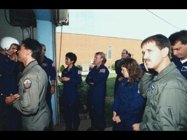 Several 1992 astronaut candidates wait in line to receive gear for one of several phases of parachute familiarization and survival training at Vance Air Force Base in Oklahoma.