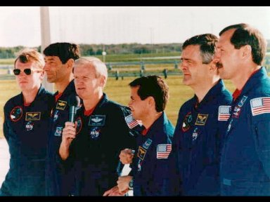 The crew talk to the news media at Launch Pad 39B, at the Kennedy Space Center (KSC).
