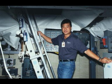 Astronaut Leroy Chiao, assigned as mission specialist for the mission, prepares to ascend stairs to the flight deck of the fixed base Shuttle Mission Simulator (SMS) at the Johnson Space Center (JSC).