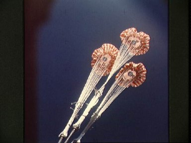 View of the parachutes of Skylab 3 command module during splashdown