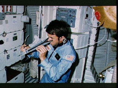 Mission Specialist Lenoir checks vision using DIOPTER measuring device