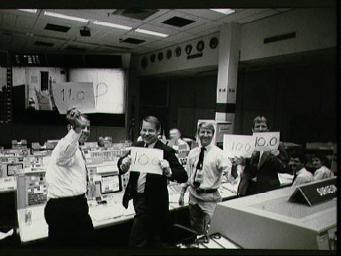 At JSC's MCC, CAPCOMs display score cards rating STS-26 Discovery landing
