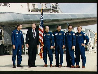 STS-26 crewmembers pose with VP Bush for post flight portrait at EAFB, CA