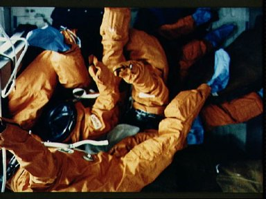 STS-26 launch and entry suits (LESs) freefloat on OV-103's middeck