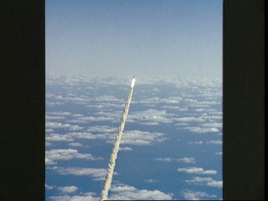 STS-27 Atlantis, OV-104, rises above clouds as it soars above KSC LC Pad 39B
