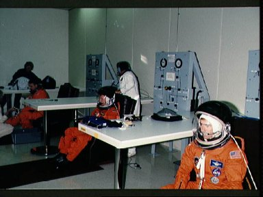STS-28 crewmembers don LESs prior to Columbia, OV-102, launch