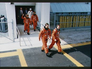 STS-30 crewmembers leave KSC O and C Bldg during launch preparations