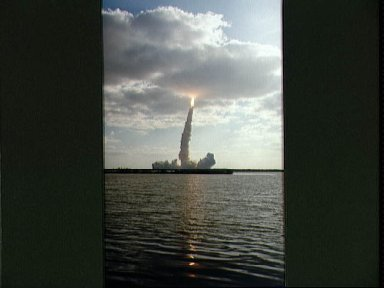 STS-31 Discovery, OV-103, is hidden in low-lying clouds after KSC liftoff