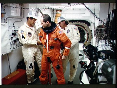 STS-32 MS G. David Low dons LES equipment in KSC LC Pad 39A white room