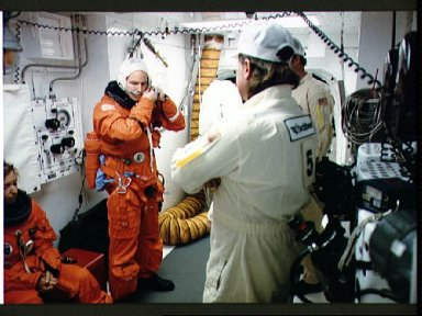 STS-32 MS G. David Low dons LES CCA in KSC LC Pad 39A white room