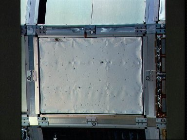 STS-32 photo survey of LDEF includes closeup of experiment tray