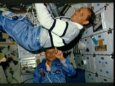 STS-33 MS Musgrave and MS Carter perform balancing act on OV-103's middeck