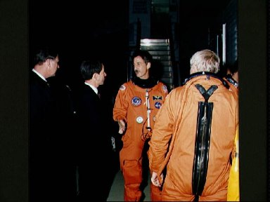 STS-35 MS Hoffman is greeted by JSC manager Puddy and NASA administrator Lenoir