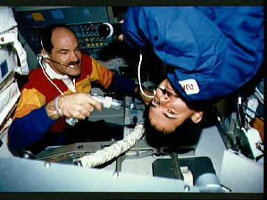 STS-35 crewmembers repair mission station component aboard OV-102