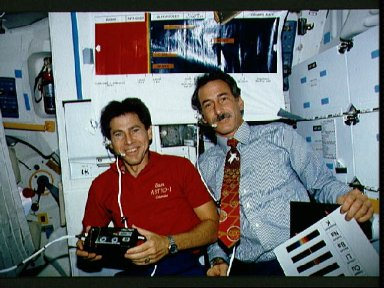 """STS-35 MS Hoffman and PS Durrance on OV-102's middeck for """"Space Classroom"""