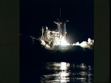 STS-36 Atlantis, OV-104, lifts off from KSC LC Pad 39A into darkness
