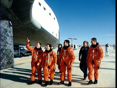 STS-37 crewmembers inspect the underside of Atlantis, OV-104, at EAFB