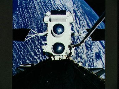 STS-37 Gamma Ray Observatory (GRO) held by RMS over OV-104's payload bay