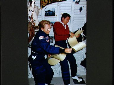 STS-40 MS Seddon and Commander O'Connor review TAGS printout on OV-102 middeck