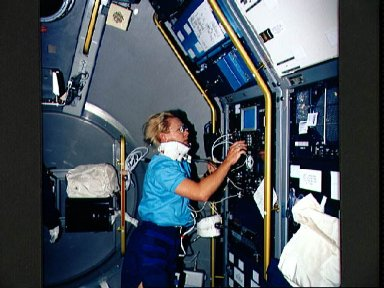 STS-40 Mission Specialist (MS) Seddon conducts Exp. No. 022 in SLS-1 module