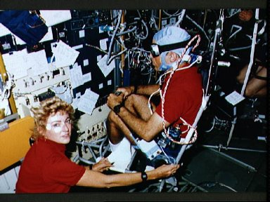 STS-40 crewmembers, working in SLS-1 module, conduct Experiment No. 072