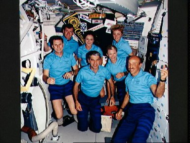 STS-40 crewmembers pose for onboard (in space) portrait on OV-102's middeck