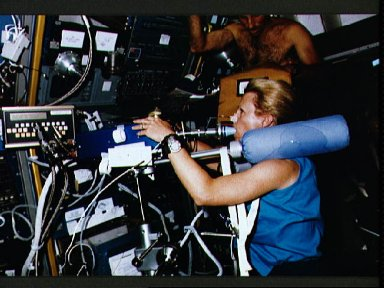 STS-40 Mission Specialist (MS) Seddon on ergometer conducts Exp. No. 066