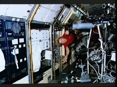 """STS-40 Payload Specialist Hughes-Fulford """"flies"""" through SLS-1 module"""