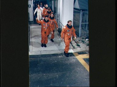 STS-41 crewmembers leave KSC O and C Bldg for Launch Complex (LC) Pad 39