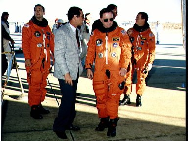 STS-41 crewmembers are greeted by NASA Officials after landing at EAFB, Calif