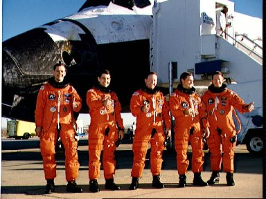 STS-41 crew poses in front of OV-103 on concrete runway 22 at EAFB, Calif
