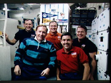 STS-41 crewmembers pose on OV-103's middeck for inflight (in-space) portrait