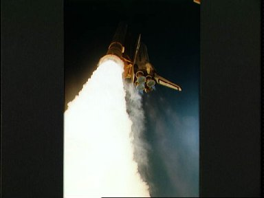 Low angle view of STS-42 Discovery, OV-103, liftoff from KSC LC Pad