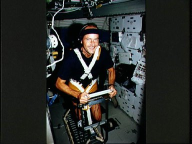 STS-43 Mission Specialist (MS) Low exercises on OV-104's middeck treadmill