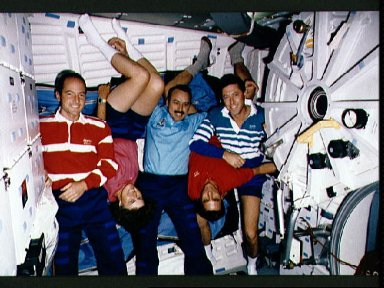 STS-43 crewmembers pose for onorbit (in space) portrait on OV-104's middeck