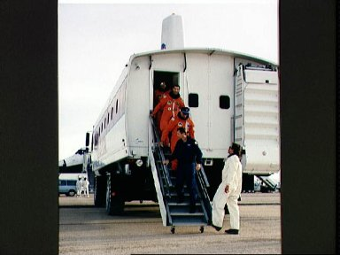 STS-44 crewmembers exit people mover after landing at EAFB, California