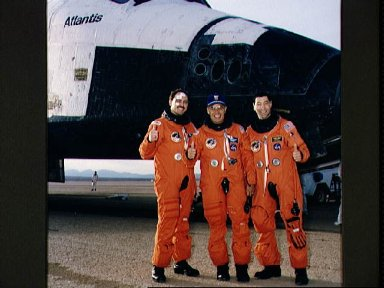 """STS-44 crewmembers give """"thumbs up"""" signal after landing at EAFB, California"""