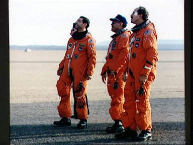 STS-44 crewmembers on EAFB runway survey post flight servicing operations