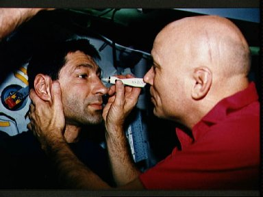 STS-44 crewmembers conduct DSO 472, Intraocular Pressure, on OV-104's middeck