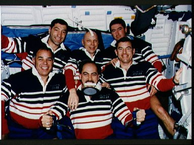 """STS-44 onboard (in-space) crew portrait features """"Trash Man"""" Hennen"""