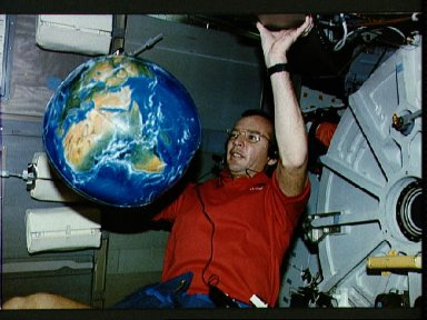 STS-45 Pilot Duffy with inflatable Earth globe on OV-104's middeck
