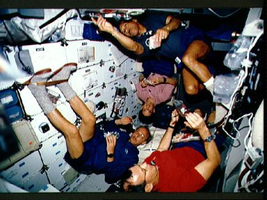 STS-45 blue shift crewmembers enjoy eating a meal on OV-104's middeck