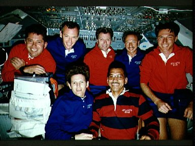 STS-45 crew poses for onboard (in-space) portrait on OV-104's flight deck