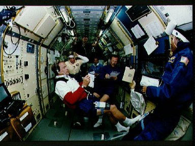 STS-47 crew in SLJ module make notes during shift changeover aboard OV-105