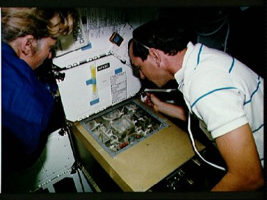 STS-47 MS Davis and Pilot Brown monitor ISAIAH on OV-105's middeck