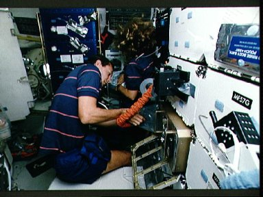 STS-47 MS Davis and Pilot Brown repair ISAIAH humidity problem aboard OV-105
