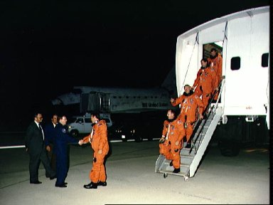 STS-48 crew, exiting CTV, is greeted by astronaut Richards at EAFB, Calif
