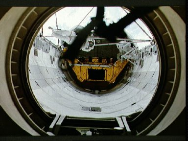 Two crewmember EVA working on the ASEM structure in the payload bay.