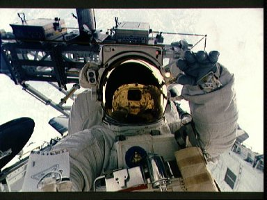 Close up portrait of an EVA crewmember in the payload bay.