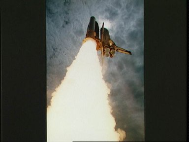 STS-50 Columbia, OV-102, soars into the sky after KSC liftoff